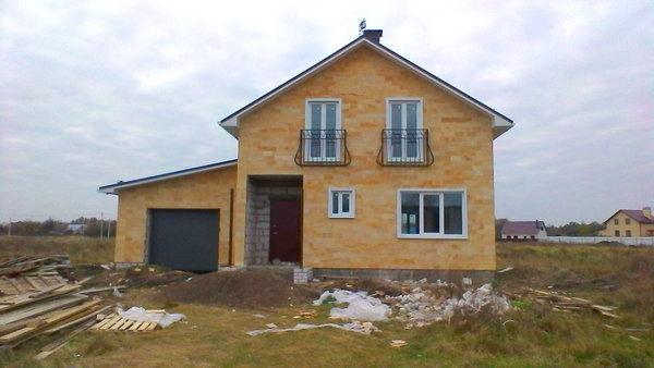 Отделка фасадов частных домов фасадными панелями цена